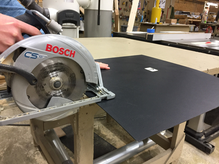 Cutting panel with a hand saw